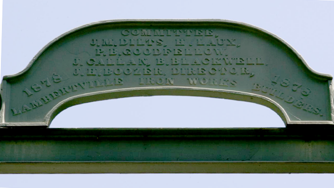 Cast iron sign atop the bridge over the Lockatong on Raven Rock Road