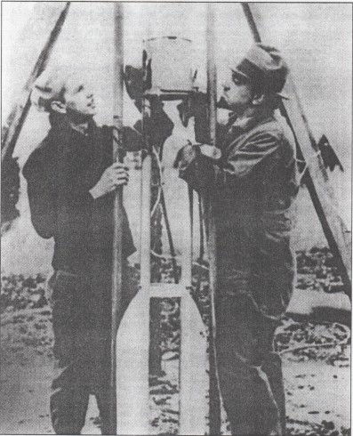 Frank Pierce and G. Pendray preparing their rocket