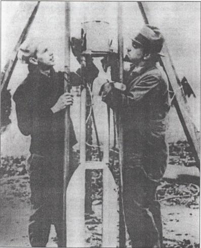 Frank Pierce and G. Pendray preparing their rocket