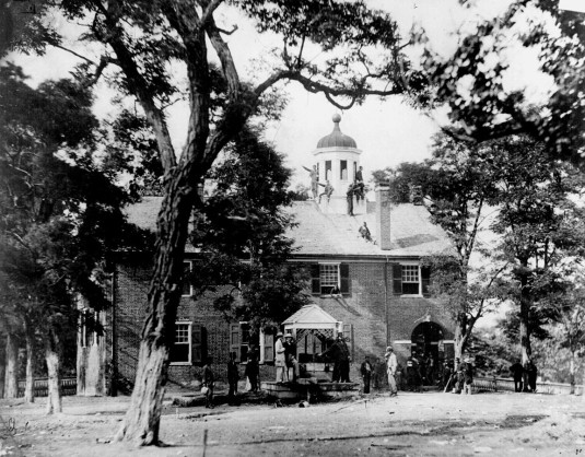 Fairfax Court House, Virginia, with Union soldiers in front and on the roof, June 1863 (from Wikipedia)