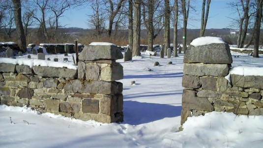 The stone wall around the cemetery where once there was a wrought iron gate