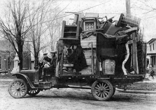 It appears that the arrival of automobiles did not change the basic logistics of moving one's household from one place to another. The above photograph was taken in the 1920s, courtesy of Google Images.